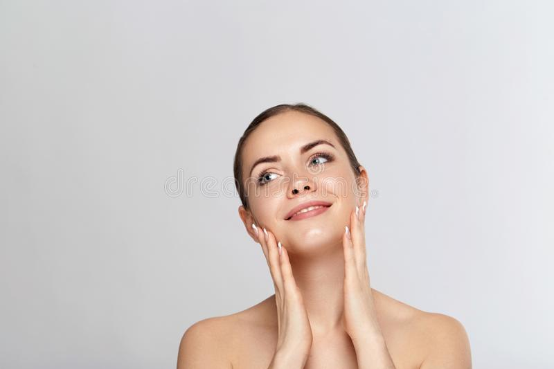 Beautiful Young Woman with Clean Fresh Skin look away .Girl beauty face care. Facial treatment. Skin care. Cosmetology, beauty and royalty free stock images