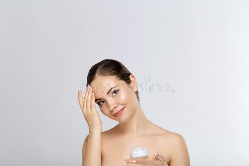 Beautiful Young Woman with Clean Fresh Skin  touch own face. Facial  treatment.  Skin care. Cosmetology, beauty and spa. royalty free stock photo