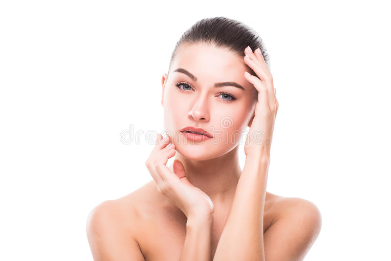 Beautiful Young Woman with Clean Fresh Skin touch own face . Facial treatment . Cosmetology , beauty and spa stock photos