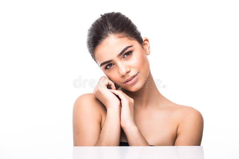 Beautiful Young Woman with Clean Fresh Skin touch own face . Facial treatment . Cosmetology , beauty and spa . Beautiful Young Woman with Clean Fresh Skin touch royalty free stock images