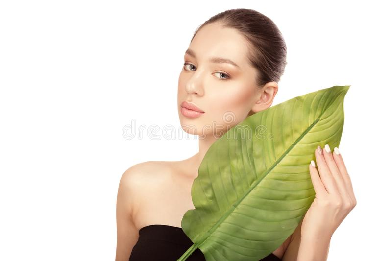 Beautiful young woman with clean perfect skin. Beauty portrait. Spa, skin care and wellness. royalty free stock images