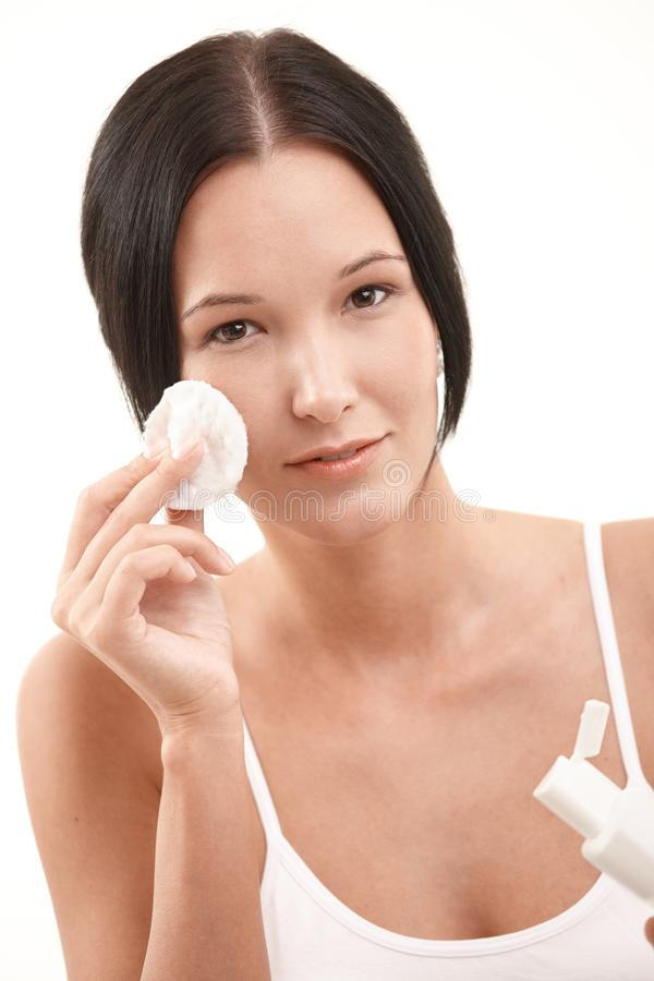 Beautiful young woman cleaning face royalty free stock images