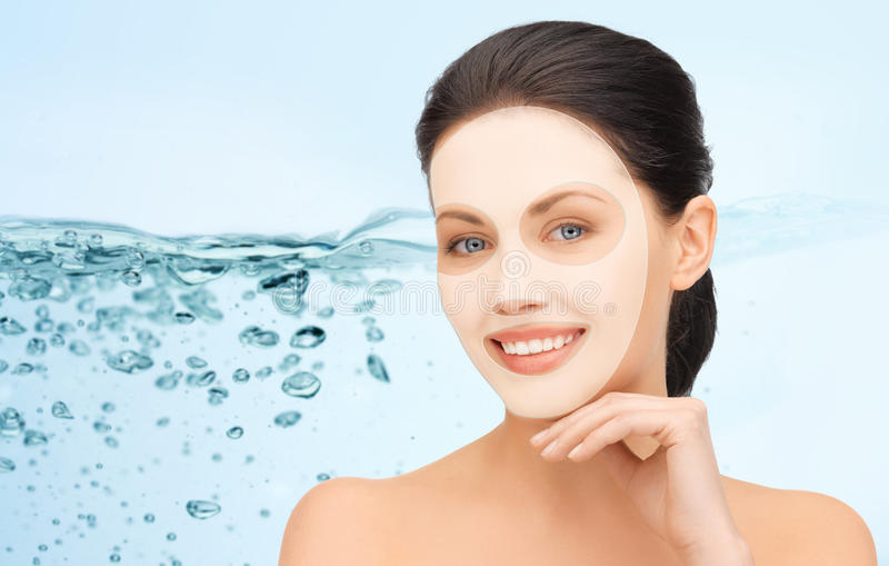 Beautiful young woman with collagen facial mask royalty free stock photos
