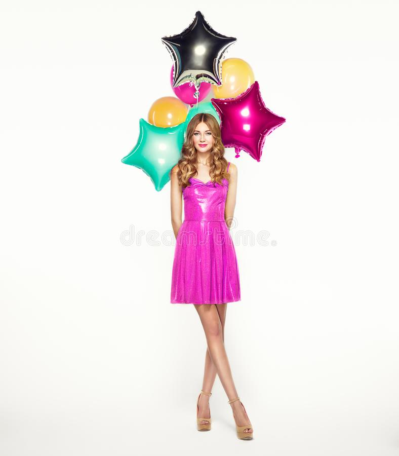 Beautiful young woman with colorful balloons royalty free stock image