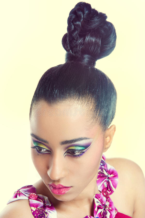 Beautiful young woman with colorful makeup stock photography