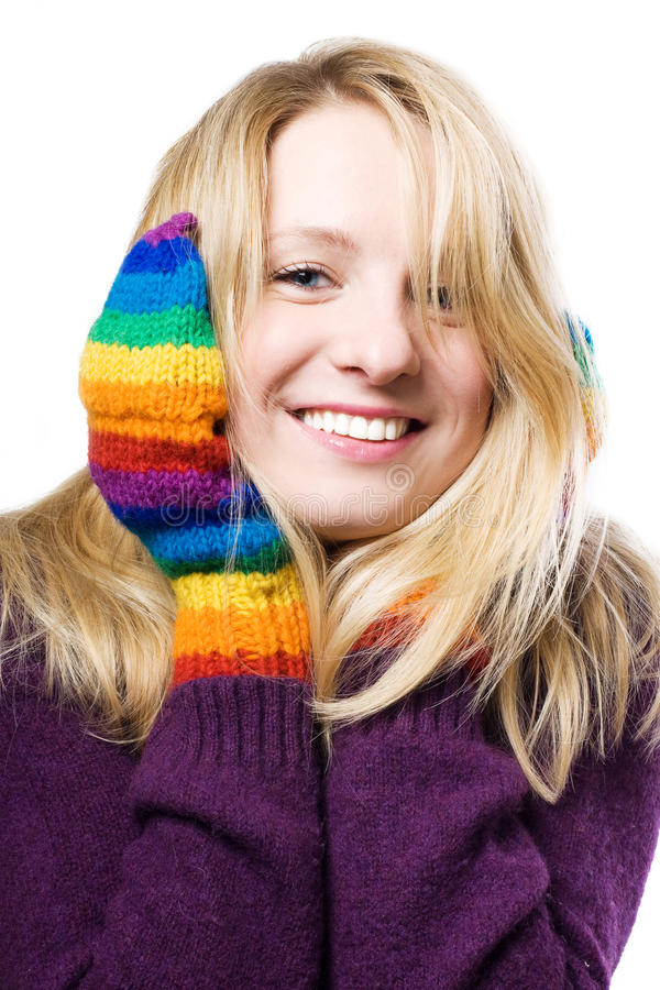 Beautiful young woman in colourful gloves stock photos
