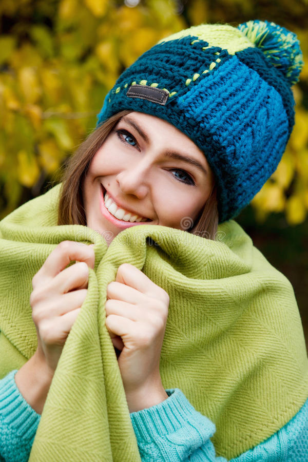 Beautiful young woman covering herself. With a blanket royalty free stock images