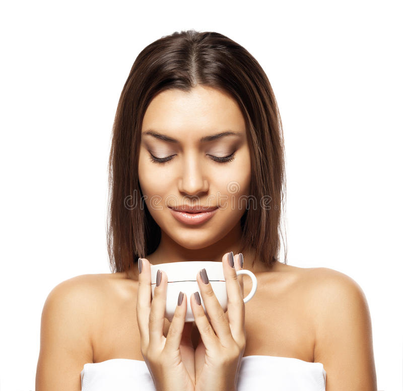Beautiful young woman with cup of coffee, on white background royalty free stock photos