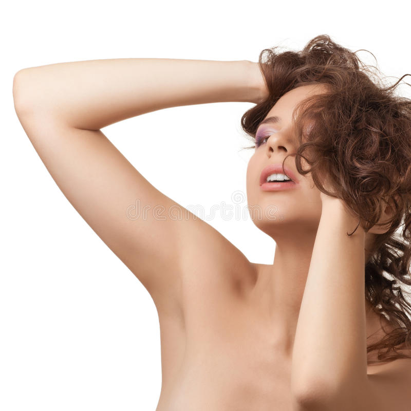 Beautiful young woman with curly hairs stock images