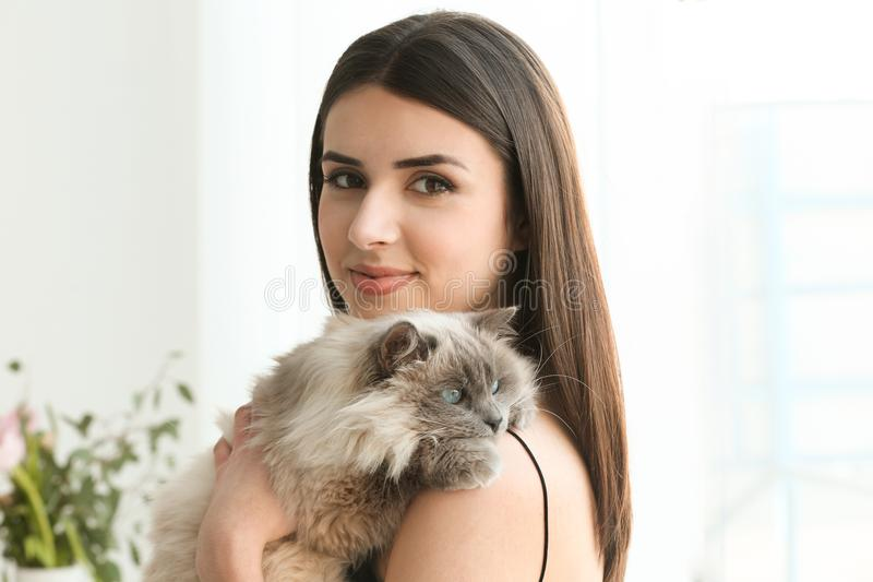 Beautiful young woman with cute cat resting at home royalty free stock images