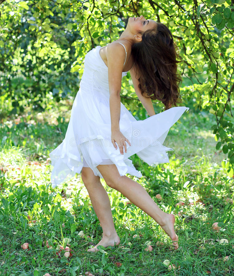 Beautiful young woman dancing stock images