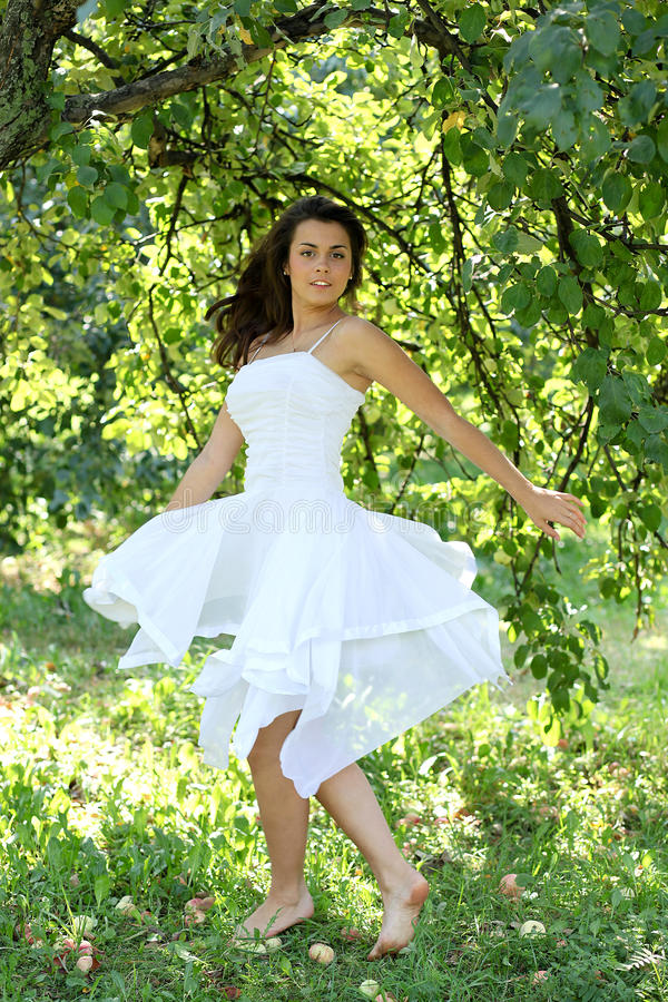 Beautiful young woman dancing stock photos