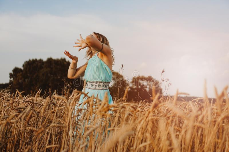 Beautiful Young Woman Dancing In The Field stock images
