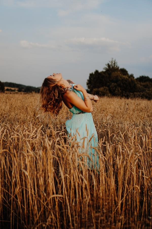 Beautiful Young Woman Dancing In The Field stock photography