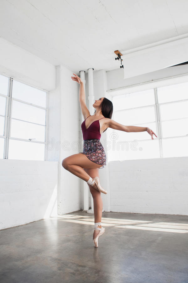 Beautiful young woman is dancing in studio stock photo