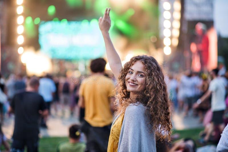 Beautiful young woman dancing at summer festival. stock photo