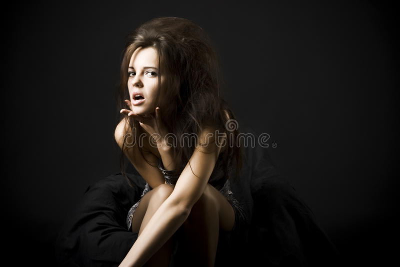 Beautiful young woman with dark hair stock photography