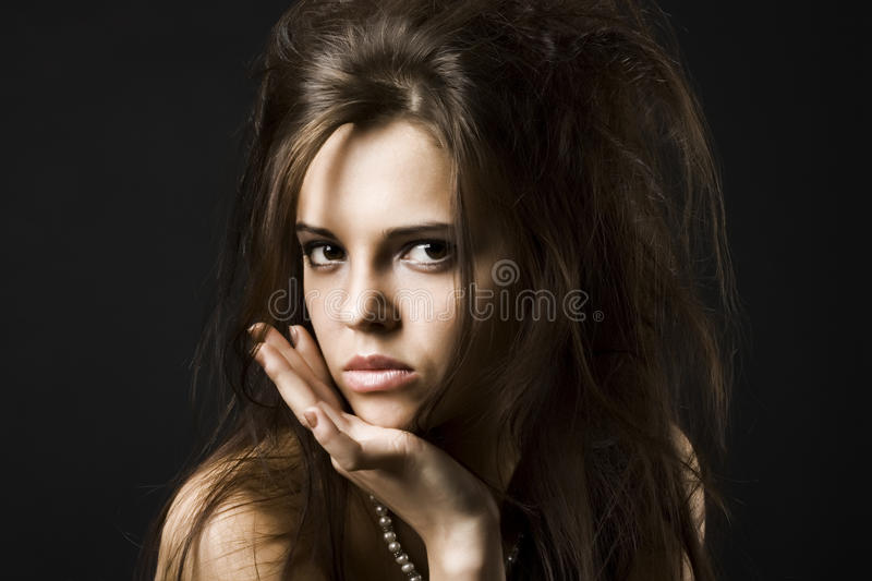 Beautiful young woman with dark hair royalty free stock photography