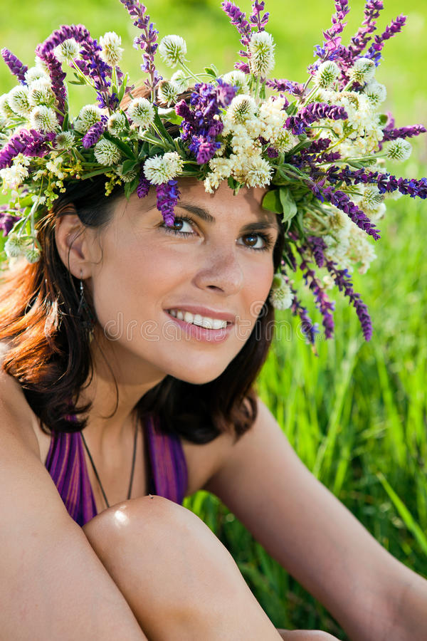 Beautiful young woman daydreaming in meadow royalty free stock images