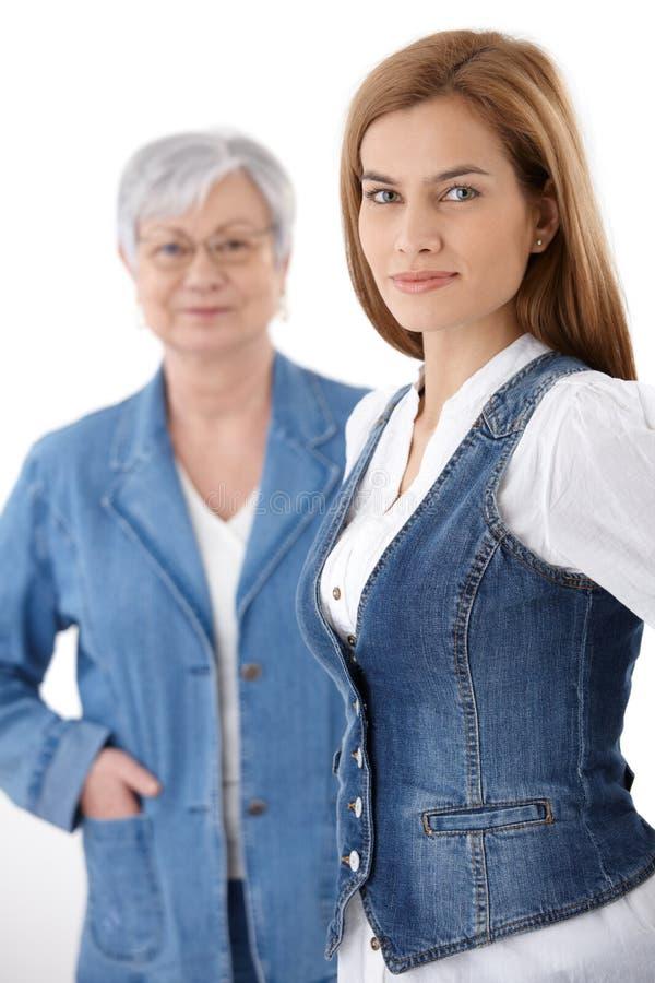 Beautiful young woman in denim waistcoat smiling stock image