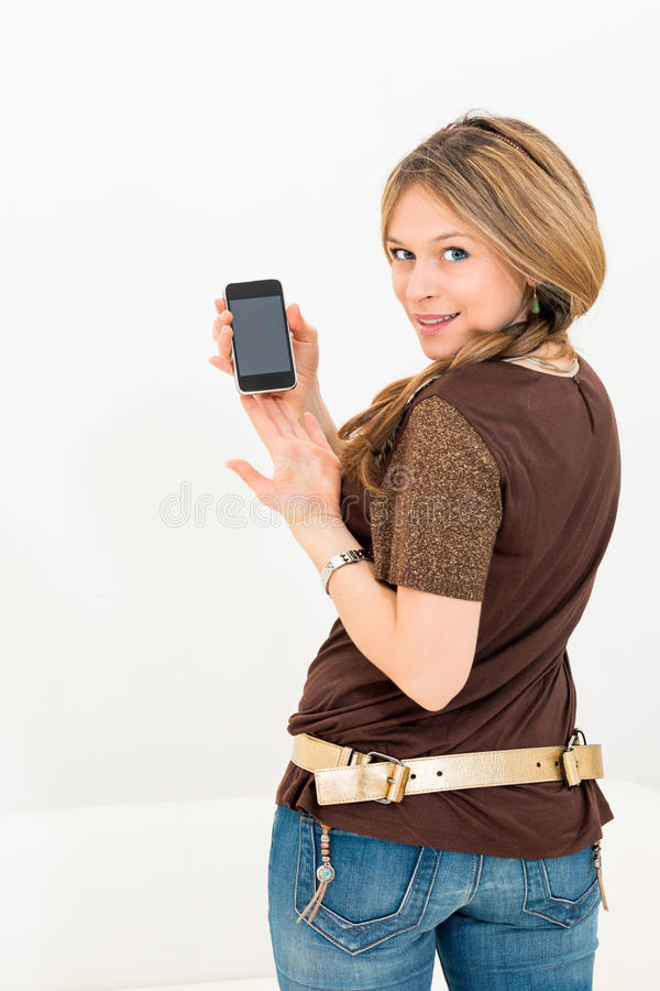 Beautiful young woman displaying mobile phone. On white background royalty free stock images