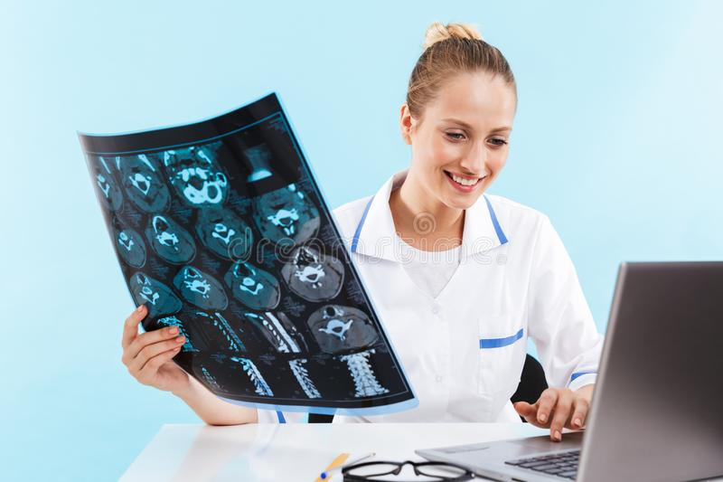 Beautiful young woman doctor wearing uniform stock images