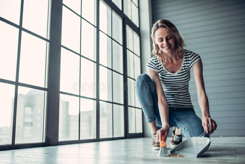 Woman doing cleaning at home royalty free stock photos