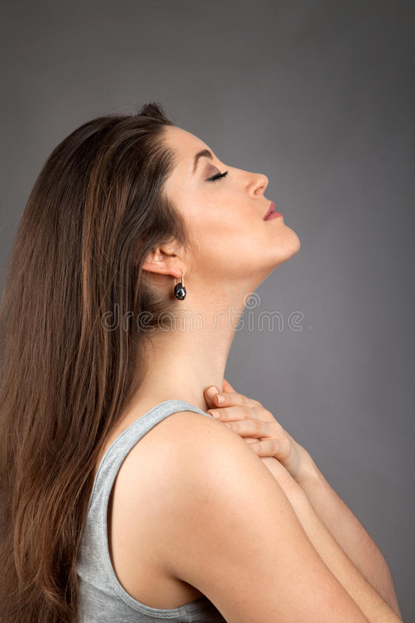 Beautiful young woman doing face yoga. Beautiful young caucasian woman doing face yoga royalty free stock photos