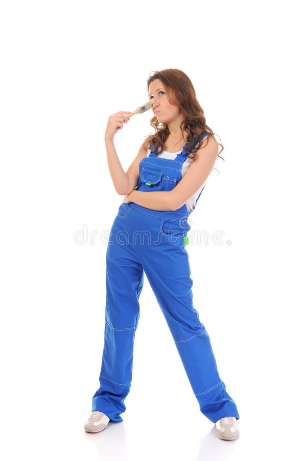 Beautiful young woman doing repairs royalty free stock photography