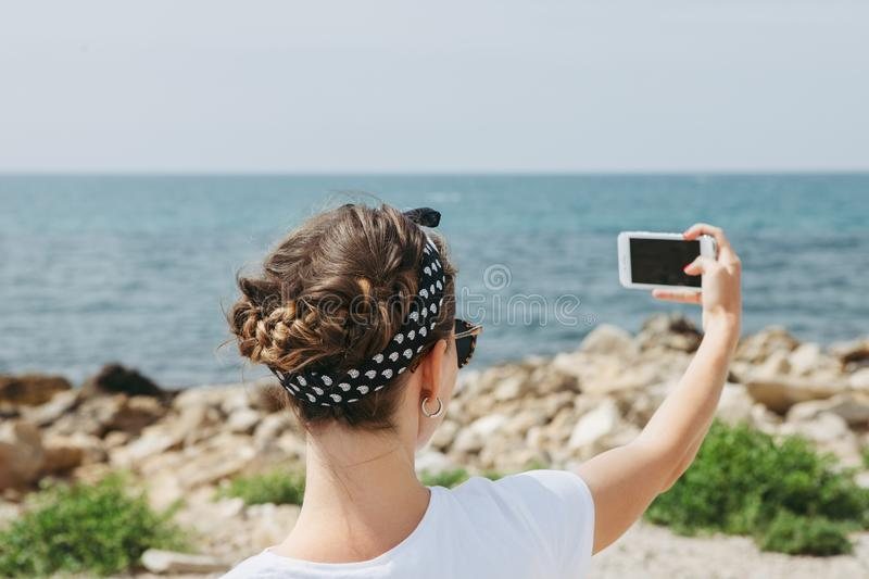 Beautiful young woman doing selfie royalty free stock photos