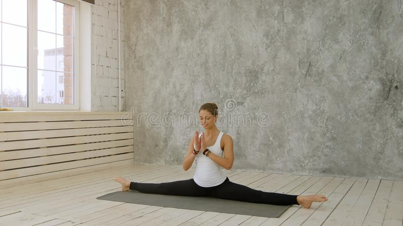 Beautiful young woman doing twin in dance studio royalty free stock photography