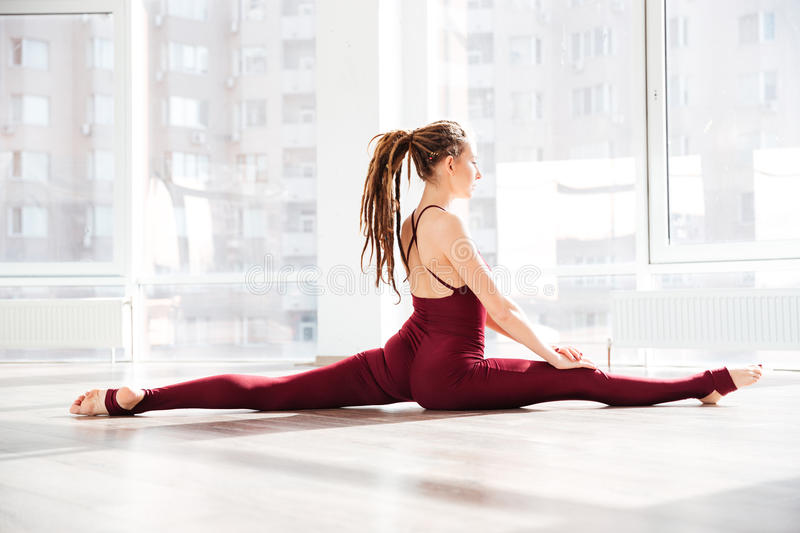 Beautiful young woman doing twin in dance studio stock images
