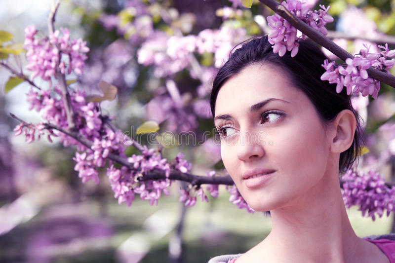 Beautiful young woman dreaming outdoors stock photography