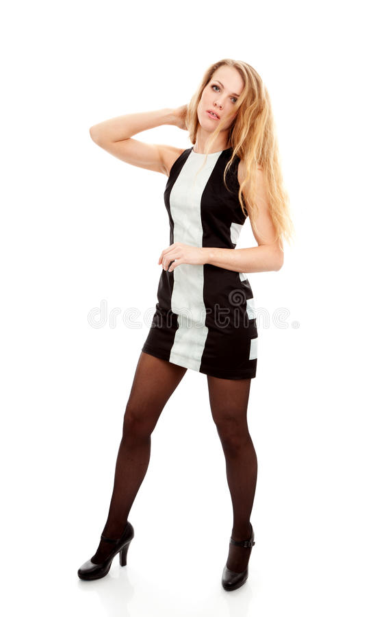 Beautiful young woman in dress stock photography