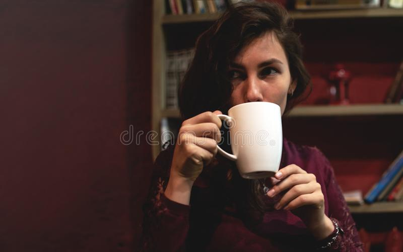 Beautiful Young Woman Drinking Coffee or Tea. Girl Start drinking decaffeinated drinks and enjoying this beverage. Lady stock image