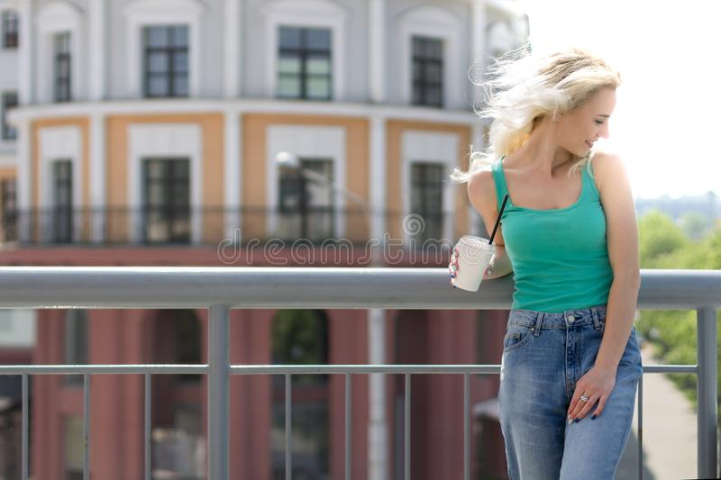 Beautiful Young Woman Drinks Coffee on the Street of the City. Copy Space stock photos