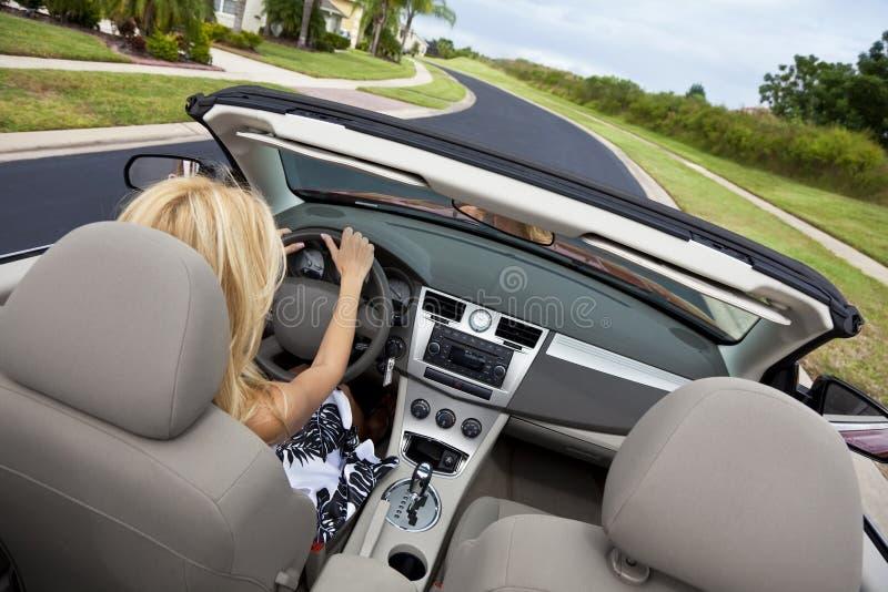 Beautiful Young Woman Driving Convertible Car royalty free stock photography