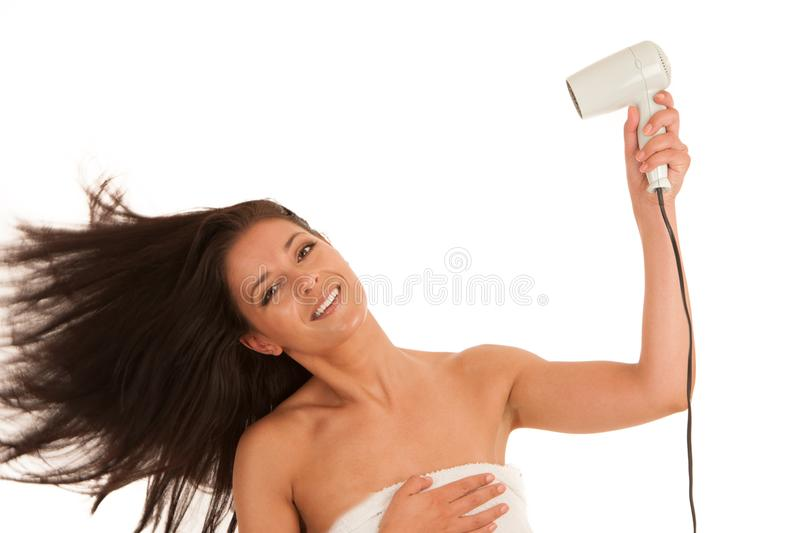 Beautiful young woman drying hair with hair dryer isolated over royalty free stock photo