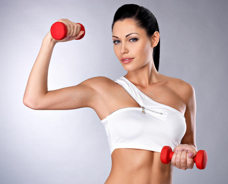 Download Beautiful Young Woman With Dumbbells Stock Photo - Image: 27654998