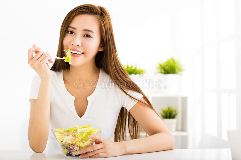 Beautiful young woman eating healthy food. Beautiful young asian woman eating healthy food royalty free stock photo