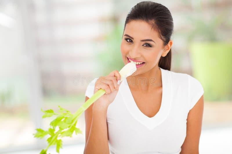 Woman eating celery royalty free stock photos