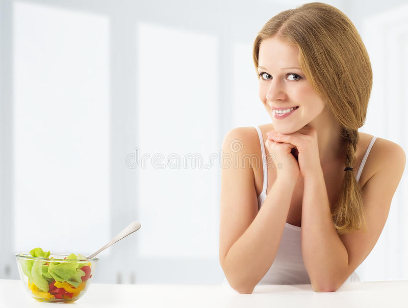 Download Beautiful Young Woman Eating Vegetable Salad Stock Image - Image: 22451113