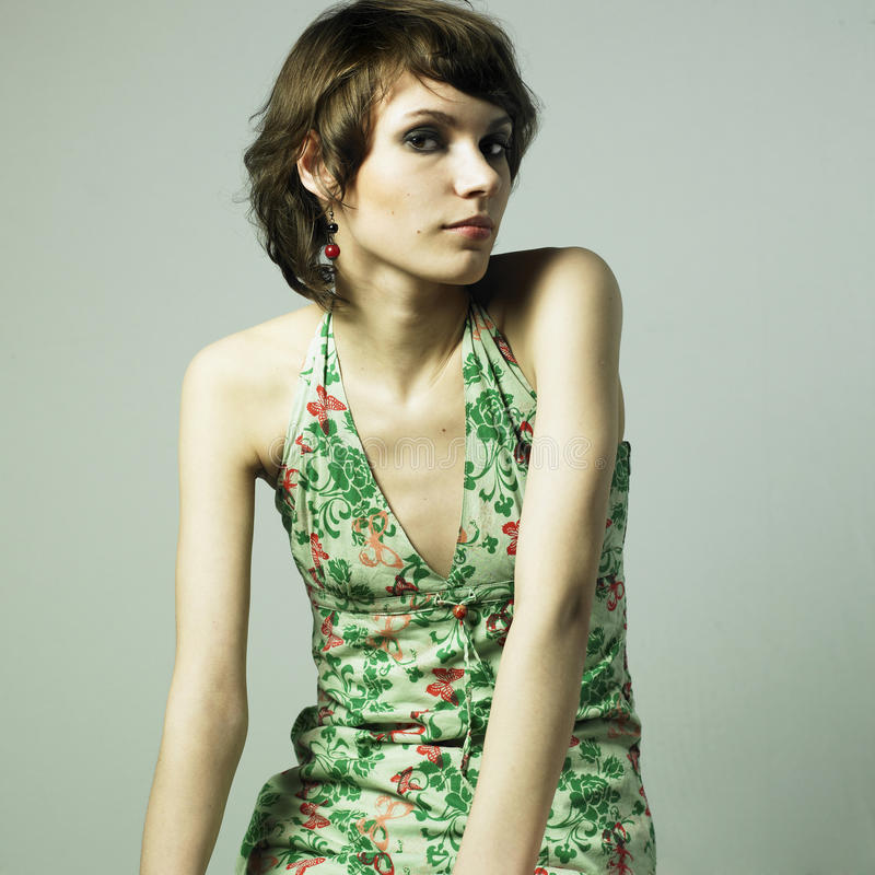Beautiful young woman in elegant dress stock image