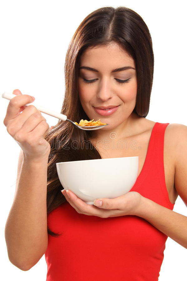Free Beautiful Young Woman Enjoying Breakfast Cereal Royalty Free Stock Image - 17471116