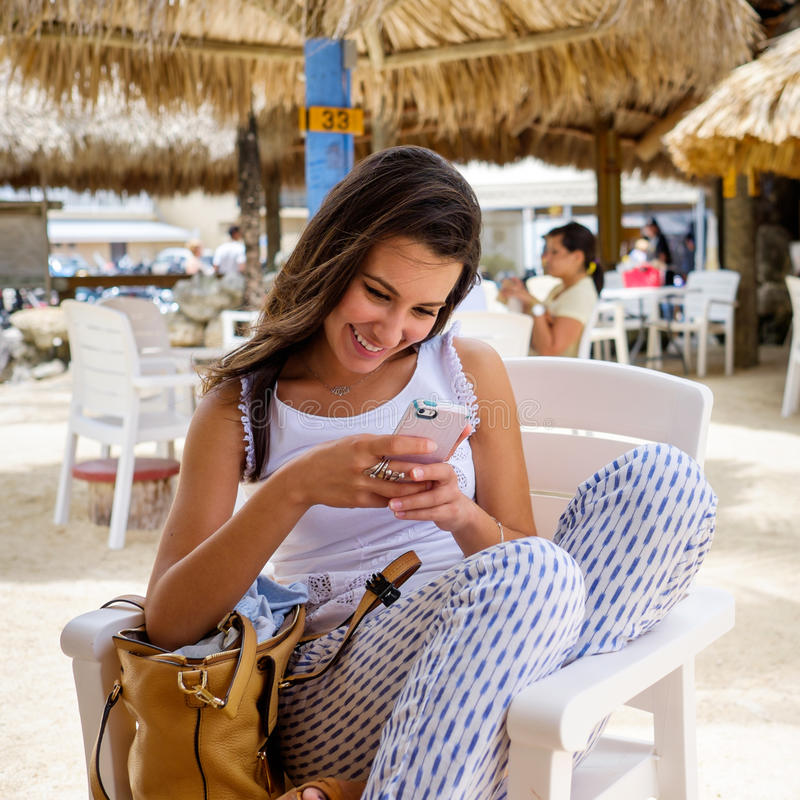 Beautiful young woman. Enjoying the outdoors in a tiki style restaurant setting in the Florida Keys stock images