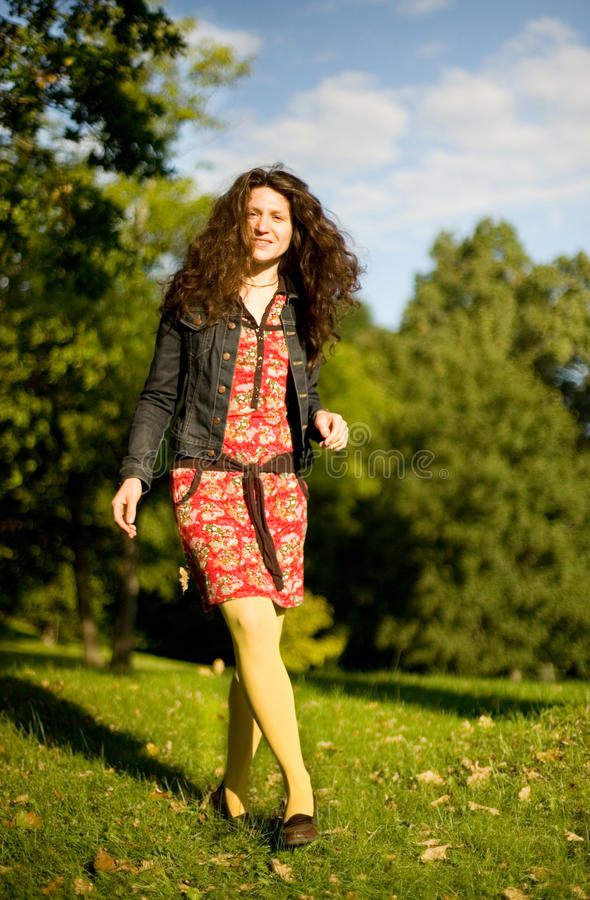 Beautiful young woman enjoying sunny day royalty free stock photo