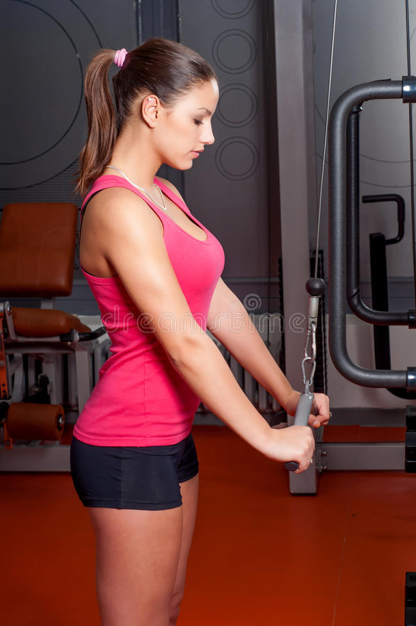 Beautiful Young Woman Exercising Arm Muscles Royalty Free Stock Photos