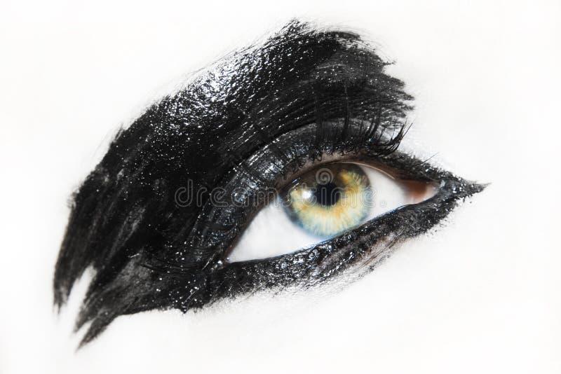 Beautiful young woman eye. Beautiful woman eye with avant garde make up stock photo