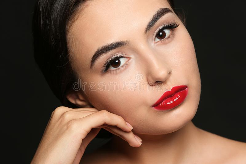 Beautiful young woman with eyelash extensions stock photo