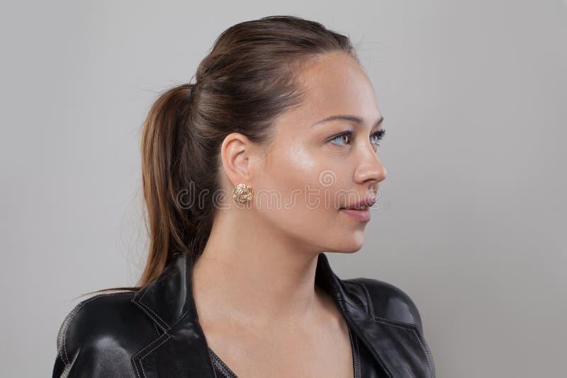 Beautiful young woman, face closeup, profile.  stock photos